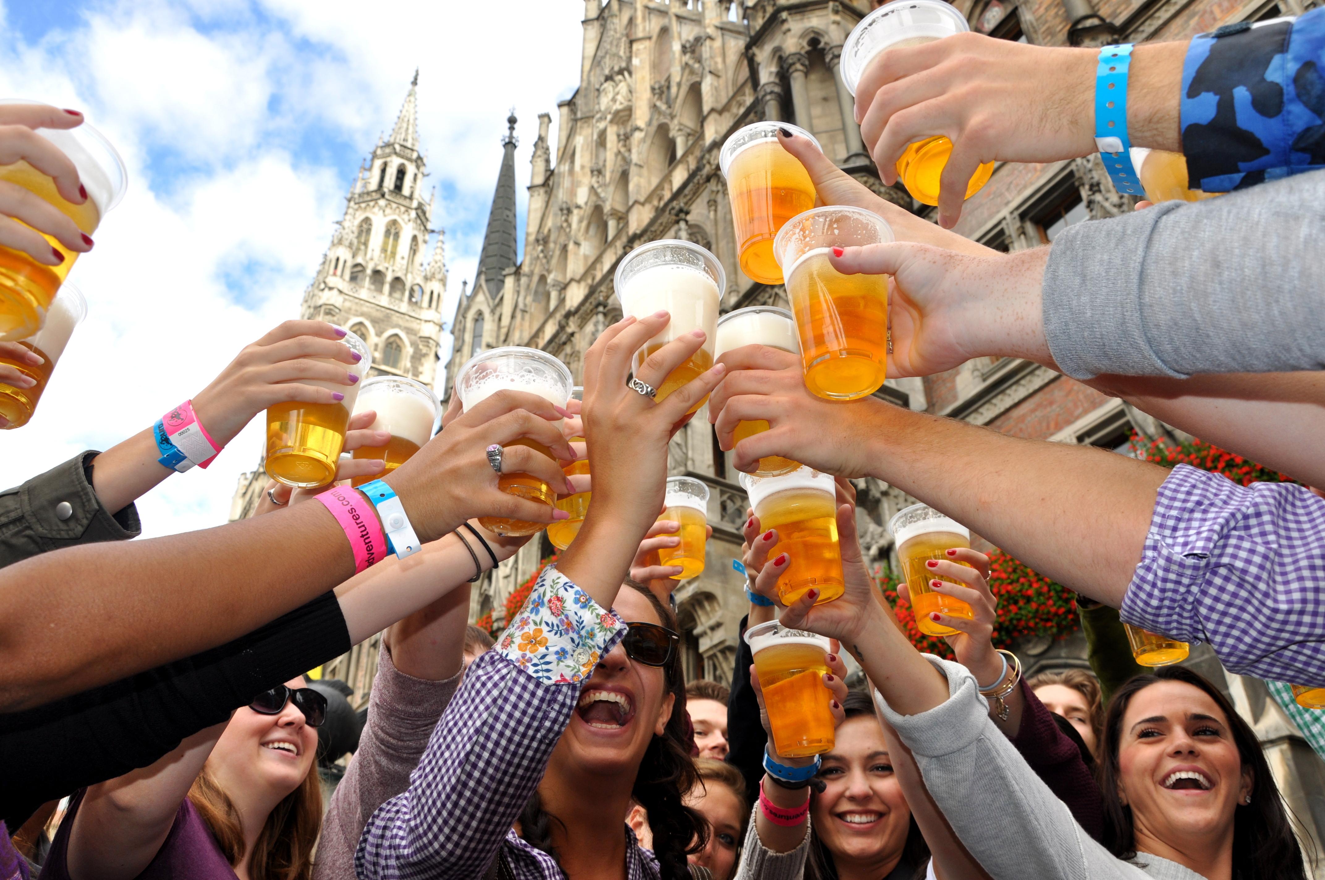people celebrating german beer for oktoberfest